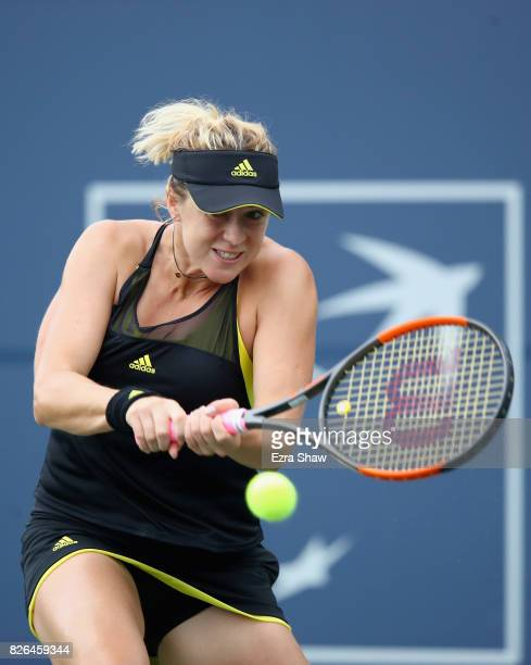 Anastasia Pavlyuchenkova of Russia returns a shot to CoCo Vandeweghe of the United States during their quarterfinal match on Day 5 of the Bank of the...