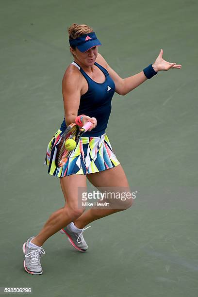 Anastasia Pavlyuchenkova of Russia returns a shot toKristina Mladenovic of France during her second round Women's Singles match on Day Four of the...