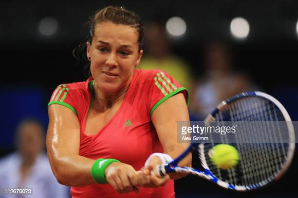 Anastasia Pavlyuchenkova of Russia returns the ball to Vera Zvonareva of Russia during their second round match at the Porsche Tennis Grand Prix at...