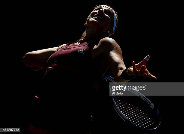 Anastasia Pavlyuchenkova of Russia serves against Nicole Gibbs of the United States on Day Four of the 2014 US Open at the USTA Billie Jean King...