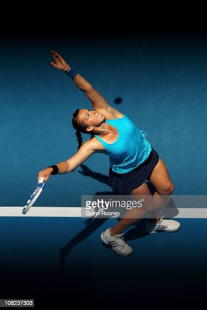 Anastasia Pavlyuchenkova of Russia serves in her third round match against Iveta Benesova of the Czech Republic during day six of the 2011 Australian...