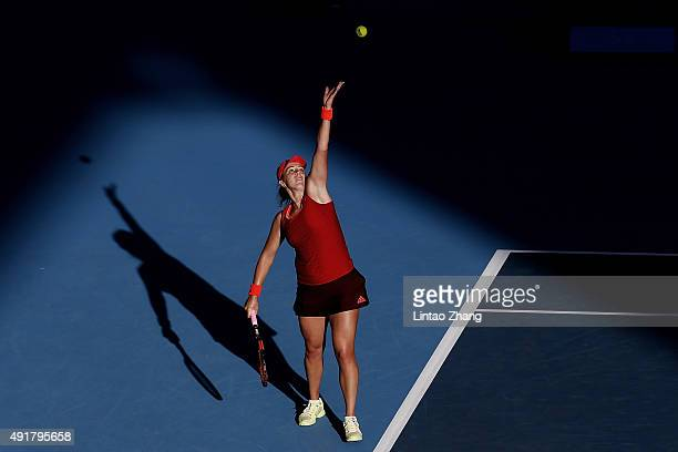 Anastasia Pavlyuchenkova of Russia serves to Flavia Penneta of Italy during the Women's singles Second round match on day six of the 2015 China Open...