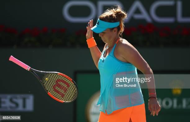 Anastasia Pavlyuchenkova of Russia throws her racket in frustration against Dominika Cibulkova of Slovakia in their fourth round match during day...