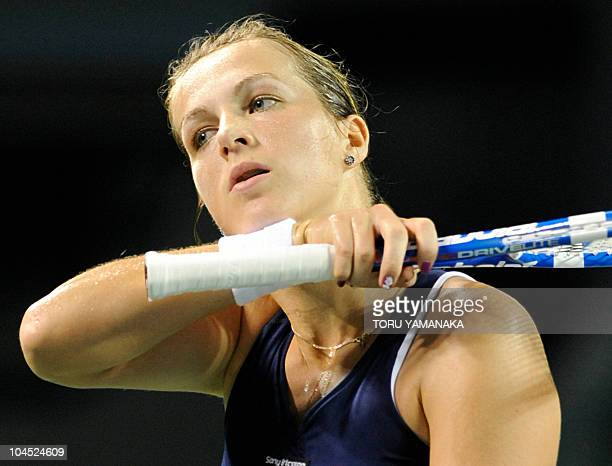 Anastasia Pavlyuchenkova of Russia wipes sweat from her chin just after losing a point against Caroline Wozniacki of Denmark during their women's...