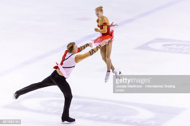 Anastasia Poluianova and Dmitry Sopot of Russia compete in the Pairs Short Program during day one of the ISU Junior Grand Prix of Figure Skating at...