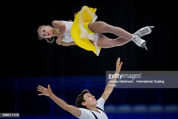 Anastasia Poluianova and Maksim Selkin of Russia compete during the pairs short program on day one of the ISU Junior Grand Prix of Figure Skating on...