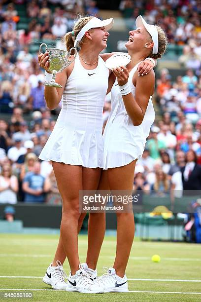Anastasia Potapova of Russia and Dayana Yastremska of Ukraine hold their trophies following the Girl's Singles Final on day twelve of the Wimbledon...