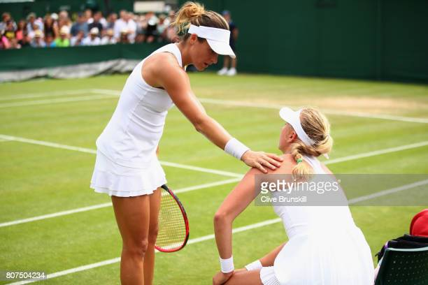 Anastasia Potapova of Russia and Tatjana Maria of Germany speak after she retired through injury after their Ladies Singles first round match against...