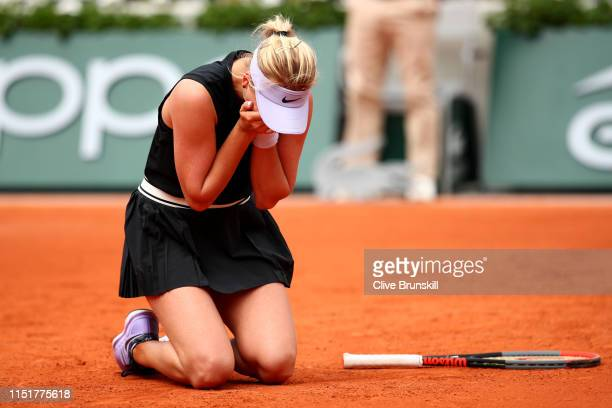 Anastasia Potapova of Russia celebrates victory in her ladies singles first round match against Angelique Kerber of Germany during Day one of the...