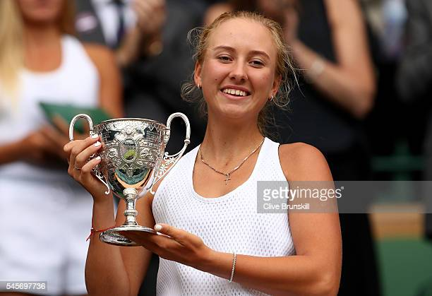 Anastasia Potapova of Russia holds the trophy following victory in the Girl's Singles Final against Dayana Yastremska of Ukraine on day twelve of the...