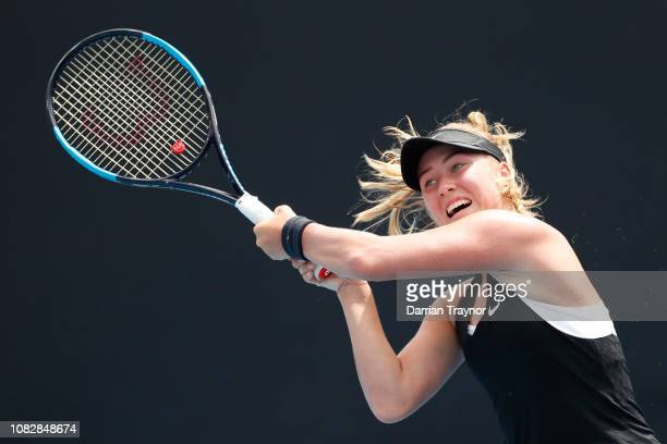 Anastasia Potapova of Russia plays a backhand in her first round match against Pauline Parmentier of France during day two of the 2019 Australian...