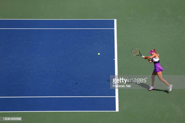 Anastasia Potapova of Russia plays a backhand in her Quarter-Final singles match against Barbora Krejcikova of The Czech Republic during Day Five of...
