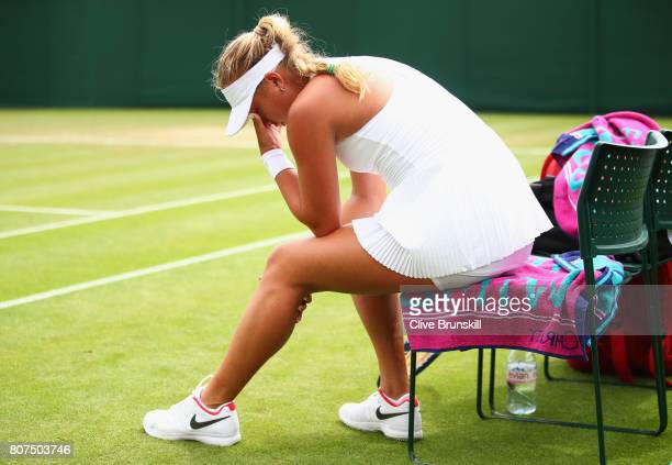 Anastasia Potapova of Russia reacts to pulling up with a injury during the Ladies Singles first round match against Tatjana Maria of Germany on day...