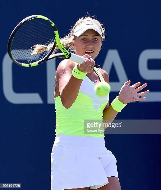 Anastasia Potapova of Russia returns a shot to Maria Mateas of the United States during her first round Junior Girl's match on Day Seven of the 2016...