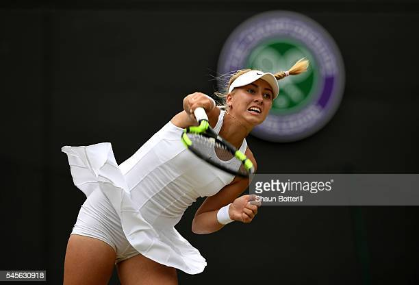 Anastasia Potapova of Russia serves during the Girls Singles Final against Danya Yastremenska of Ukraine on day twelve of the Wimbledon Lawn Tennis...