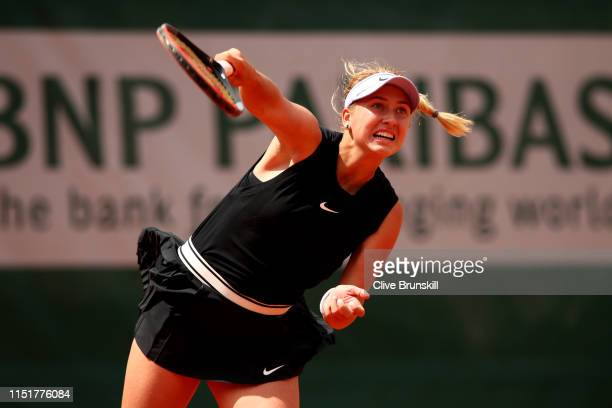 Anastasia Potapova of Russia serves in her ladies singles first round match against Angelique Kerber of Germany during Day one of the 2019 French...