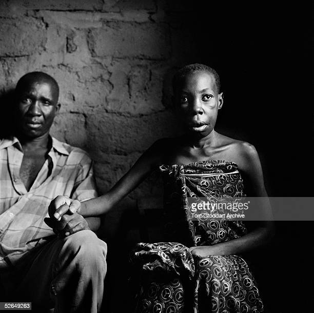 Anastasia Protas who is ill with AIDS pictured with her husband Budaga at their home in Mwanza Tanzania The couple has 5 daughters and a son who are...