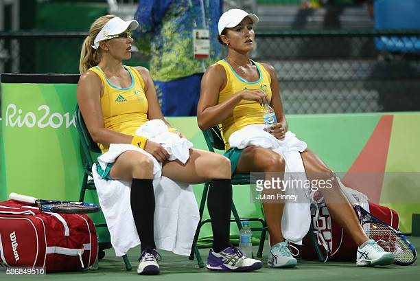 Anastasia Rodionova and Arina Rodionova of Australia in their doubles match against Elena Vesnina and Ekaterina Makarova of Russia on Day 1 of the...