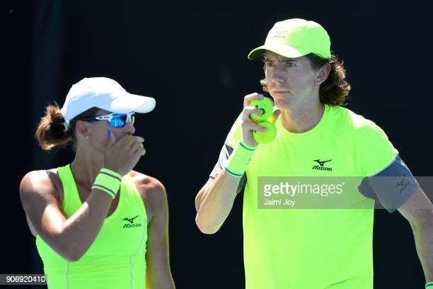 Anastasia Rodionova of Australia and JohnPatrick Smith of Australia talk tactics in their first round mixed doubles match against Vania King of the...