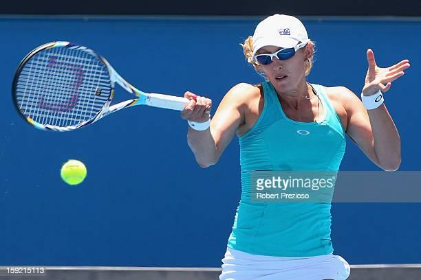 Anastasia Rodionova of Australia plays a forehand during her matach against Nastassja Burnett of Italy during Australian Open qualifying at Melbourne...