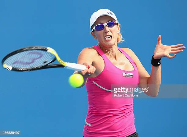 Anastasia Rodionova of Australia plays a forehand in her singles match against Gretta Arn of Hungary during day one of the 2012 Hobart International...