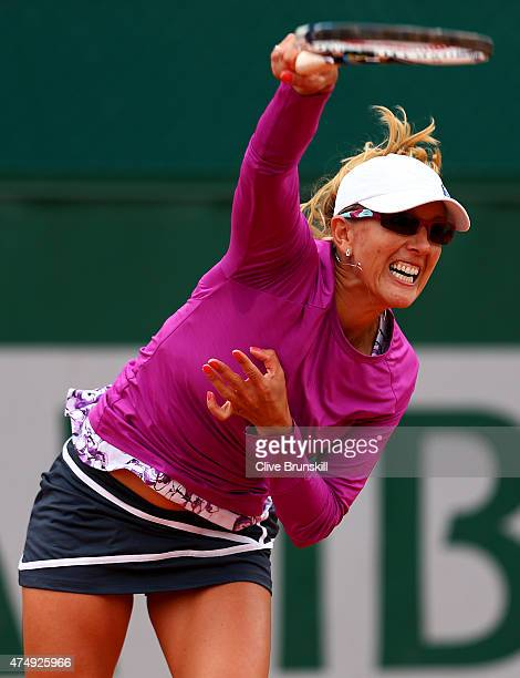 Anastasia Rodionova of Australia serves next to her partner AisamulHaq Quresji of Pakistan during a break in their mixed doubles match against Chloe...
