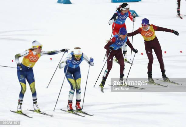 Anastasia Sedova of Olympic Athlete from Russia hands over to Anna Nechaevskaya of Olympic Athlete from Russia during the Ladies' 4x5km Relay on day...