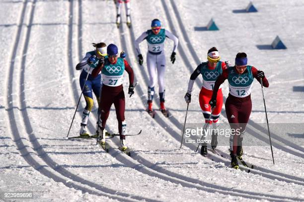Anastasia Sedova of Olympic Athlete from Russia leads the group during the Ladies' 30km Mass Start Classic on day sixteen of the PyeongChang 2018...