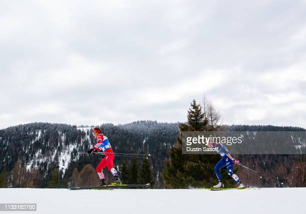 Anastasia Sedova of Russia and Sadie Bjornsen of the United States compete in the Women's 30km Cross Country mass start during the FIS Nordic World...