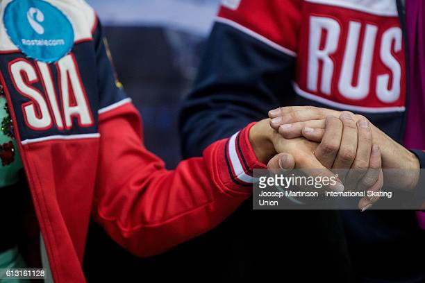 Anastasia Shpilevaya and Grigory Smirnov of Russia hold hands at kiss and cry after competing in the Junior Ice Dance Free Dance on day two of the...