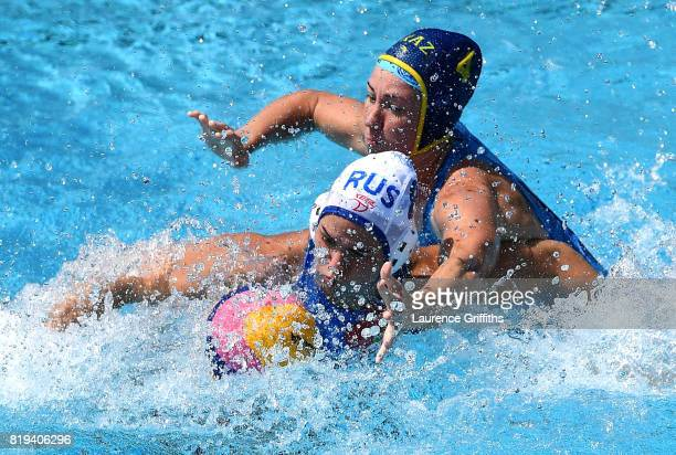 Anastasia Simanovich of Russia is challenged by Anna Turova of Kazakhstan is challenged during the Women's Water Polo Group D preliminary round match...