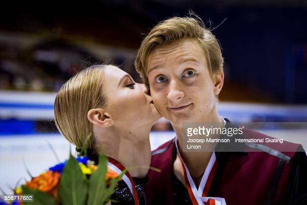 Anastasia Skoptcova and Kirill Aleshin of Russia pose in the Ice Dance medal ceremony during day three of the ISU Junior Grand Prix of Figure Skating...