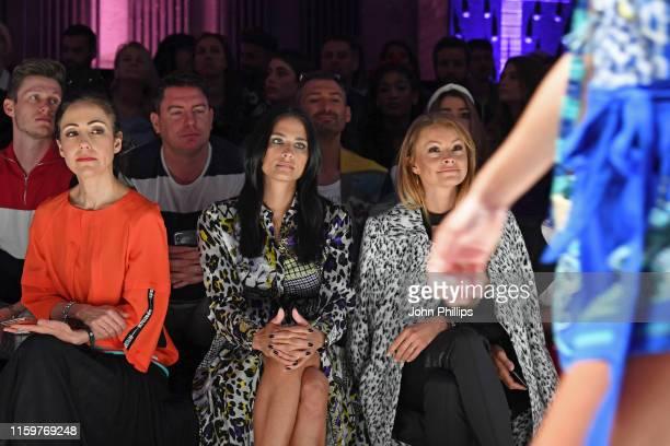Anastasia Zampounidis Amira Aly and Jana Julie Kilka watch the Sportalm Kitzbuehel show during the Berlin Fashion Week Spring/Summer 2020 at ewerk on...