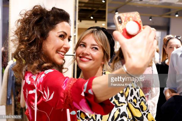 Anastasia Zampounidis and Laura Oswald attend the BestSecret store opening on August 29 2019 in Frankfurt am Main Germany