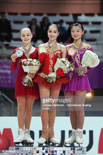 Anastasiia Gubanova and Alina Zagitova of Russia and Kaori Sakamoto of Japan pose during Junior Ladies medal ceremony on day two of the ISU Junior...