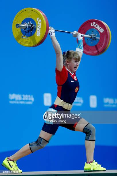 Anastasiia Petrova of Russia competes in the Women's 58kg Weightlifting on day three of the Nanjing 2014 Summer Youth Olympic Games at Nanjing...