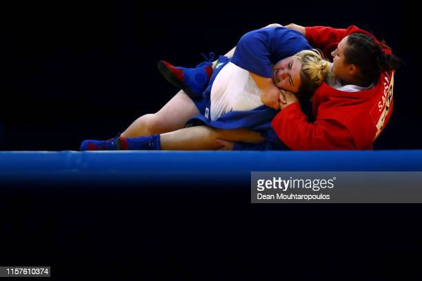 Anastasiia Sapsai of the Ukraine competes on her way to winning against Elene Kebadze of Georgia during Women's 80kg Sambo Gold Medal match Final...