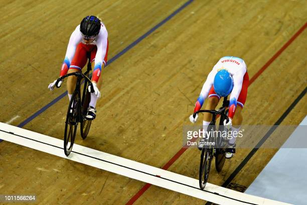 Anastasiia Voinova of Russia races against Daria Shmeleva of Russia in the first race of the final of the Women's Sprint during the track cycling on...