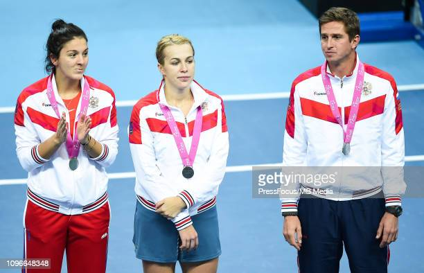 Anastasija Potapowa Igor Andreev and Anastasia Pavlyuchenkova of Russia pose after getting their winners medals during the Fed Cup Europe and Africa...