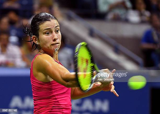 Anastasija Sevastova of Lativa returns a shot to Garbine Muguruza of Spain during her second round Women's Singles match on Day Three of the 2016 US...