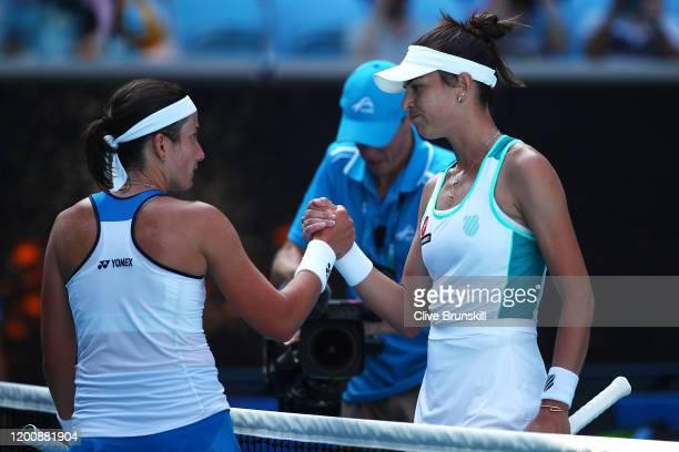 Anastasija Sevastova of Latvia and Ajla Tomljanovic of Australia embrace at the net following their Women's Singles first round match on day two of...