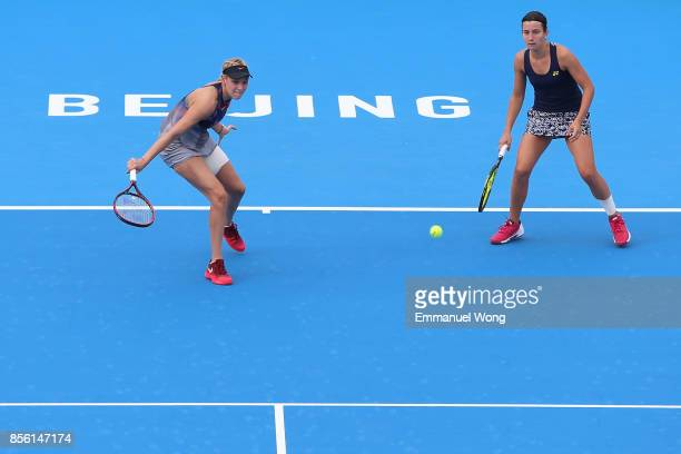 Anastasija Sevastova of Latvia and Donna Vekic of Croatia return a shot against Sloane Stephens of USA and Heather Watson of Great Britain on day two...