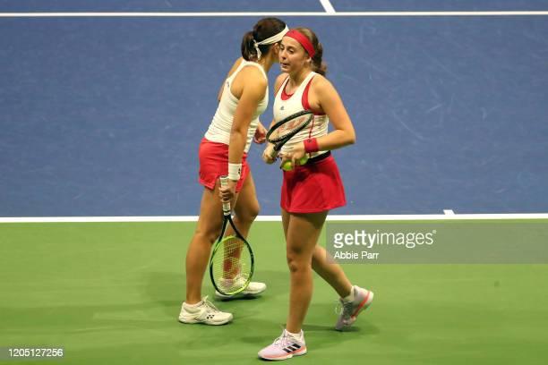 Anastasija Sevastova of Latvia and Jelena Ostapenko of Latvia react while competing against Sofia Kenin of USA and Bethanie MattekSands of USA in the...