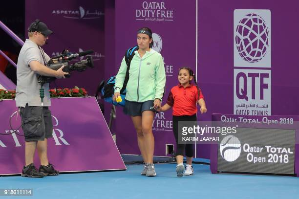 Anastasija Sevastova of Latvia arrives for her match against Simona Halep of Romania in the round of 16 during the Qatar Open tennis competition in...