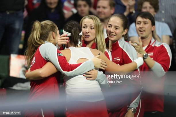 Anastasija Sevastova of Latvia celebrates with teammates after beating Serena Williams of the United States to win her match 76 36 and 76 during the...