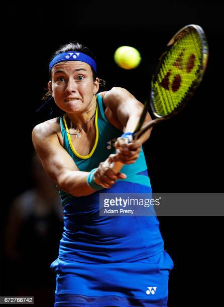 Anastasija Sevastova of Latvia hits a backhand in her match against Samantha Stosur of Australia during the Porsche Tennis Grand Prix at Porsche...