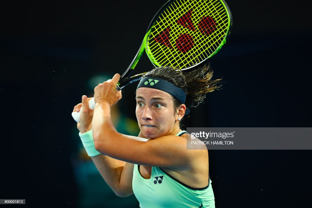 Anastasija Sevastova of Latvia hits a return against Samantha Stosur of Australia during their first round match at the Brisbane International tennis tournament at Pat Rafter Arena in Brisbane on December 31, 2017. / AFP PHOTO / Patrick HAMILTON / -- IMAGE