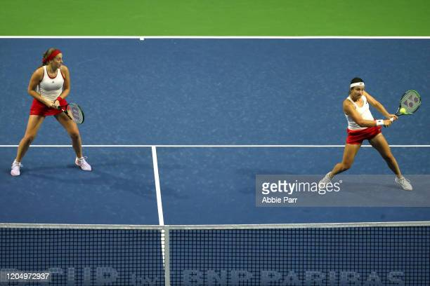 Anastasija Sevastova of Latvia hits the ball alongside Jelena Ostapenko of Latvia while competing against Sofia Kenin of USA and Bethanie MattekSands...