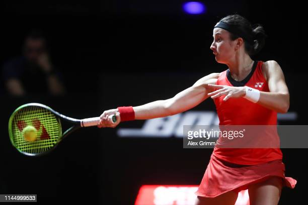 Anastasija Sevastova of Latvia on plays a forehand to Laura Siegemund of Germany during their round of 16 match on day 4 of the Porsche Tennis Grand...