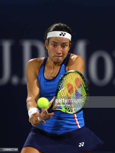 Anastasija Sevastova of Latvia plays a backhand against Marketa Vondrousova of Czech Republic during her Women's Singles match on Day One of the...